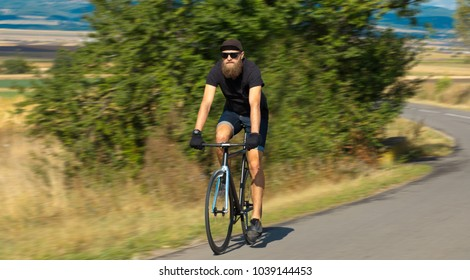 Natural view with cyclist going somewhere with stylish bike