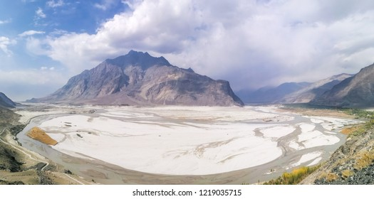 A natural view of desert with mountains and indus river in Shigar, Gilgit Baltistan, Pakistan.