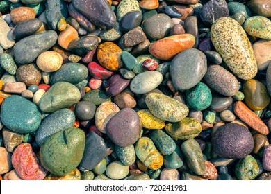 Natural vintage colorful pebbles background.