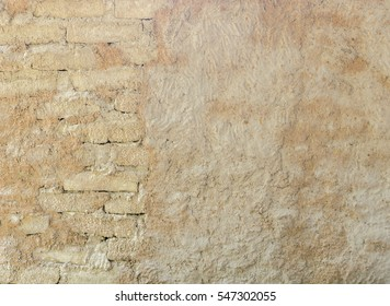 Natural wall texture of cob house for background. It is a natural building material made from subsoil, water and straw fibrous organic material.