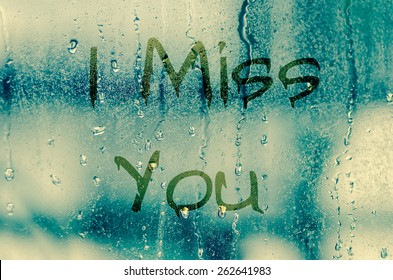 """natural water drops on glass window with the text """"I miss you"""""""