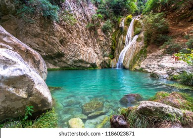 Natural waterfall and lake in Polilimnio area in Greece. Polimnio is a complex of waterfalls and lakes are located near Charavgi Municipality, Messinia prefecture, Peloponnese, Greece.