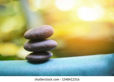 Natural wellness concept / Relax zen stones stack on wooden nature green background Spa Natural Alternative Therapy With Massage Stones