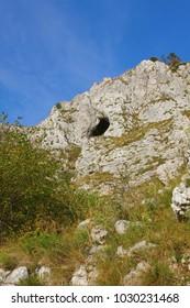 Natural window in rock, Vipava valley, Slovenia - Shutterstock ID 1030231468