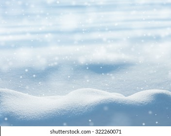 Natural winter background with snow drifts and falling snow - Shutterstock ID 322260071