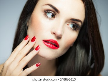 Natural woman face with red nails and lips, beauty portrait