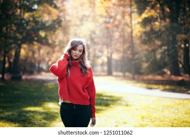 Natural woman in soft warm knitted sweater walking outdoors