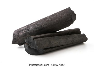 Natural wood charcoal on white background