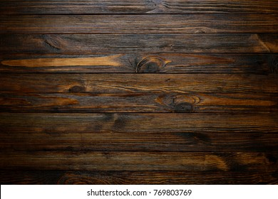 Natural wood texture. Wood background. Dark rustic planks table top flat lay view.
