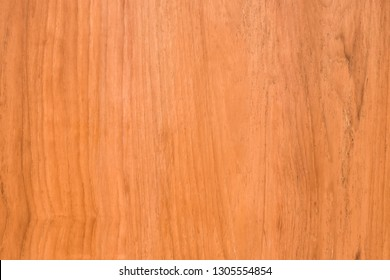 Natural of wood texture background. Pattern Teak wood for design. Top view close up to Golden color of wood.