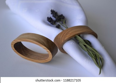 Natural wood unusual form napkin holders from oak wood. Cnc engraved, personalized napkin rings and holders for any kind of occasion. Personalized table decors for wedding table.