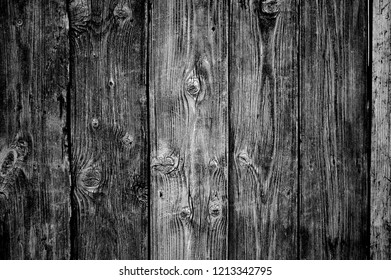 natural wood vertical slats. rustic wood board background, black and white photo.