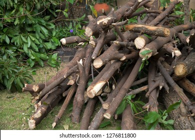 Natural wooden background, closeup of chopped firewood. Firewood stacked and prepared for winter. Pile of wood logs. Chopped firewood on a stack.