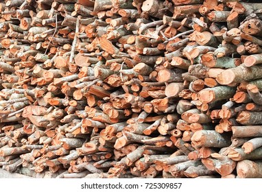 Natural wooden background. Firewood stacked and prepared for cooking and winter.