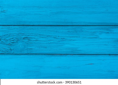 Natural wooden blue boards, wall or fence with knots. Painted wooden horizontal planks. Abstract textured background, empty template