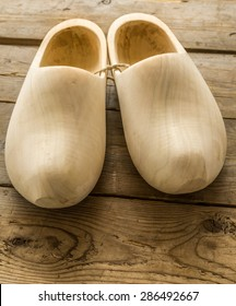 Natural Wooden classic dutch clog shoes on the wooden table