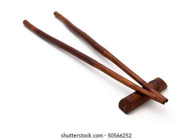 Natural wooden historical chopsticks isolated on white