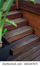 Natural wooden stairs going on a terrace deck