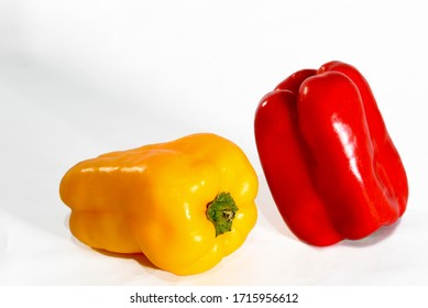 natural yellow and redpepper isolated on white background