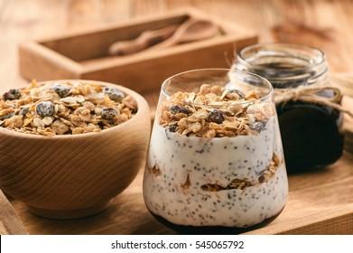 Natural yogurt with chia seed, muesli and jam.