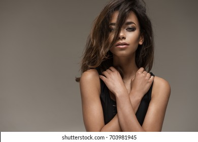 Natural young afro woman in black clothes