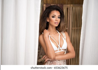Natural young afro woman in white swimwear