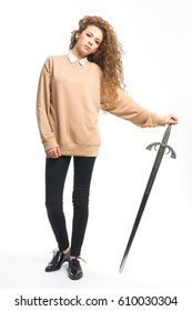 Natural young girl on white background, with medieval sword