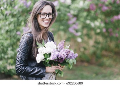 Natural young sexy woman with lilac flowers. Looks like film photo