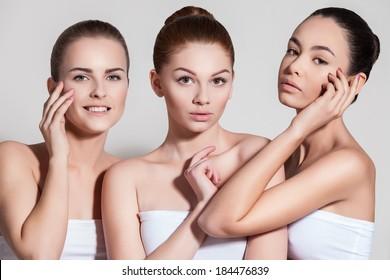 Naturally beautiful three woman with flawless skin