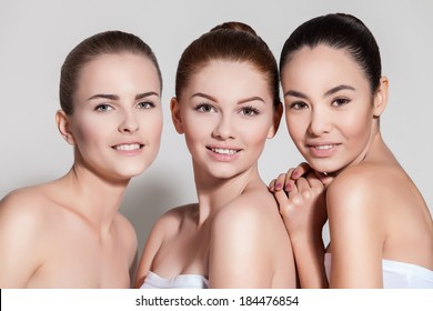 Naturally beautiful three woman with flawless skin