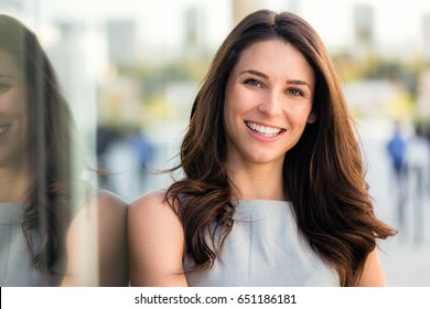Naturally beautiful woman with perfect white teeth smile, genuine, positive, happy, smiling