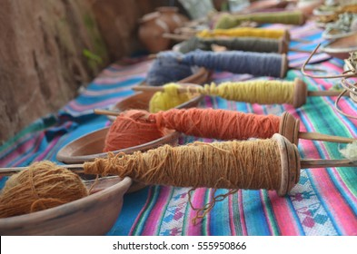 Naturally dyed Alpaca wool being used for traditional weavings in a workshop in the Peruvian Andes