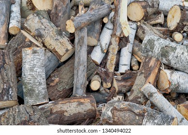 Nature abstract of a pile of old wooden logs used for fires