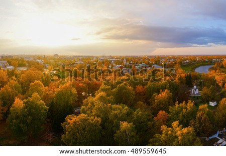 Nature aerial scene theme of the city park at the sunset. Autumnal landscape at sunset. Autumn view of natural forest at autumn. Outdoor nature panorama.