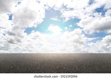 Nature asphalt road and sky cloud scenery with the sunlight. Empty new asphalt road and sky.