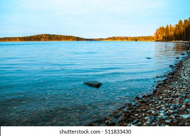 Nature autumn. The lake and beach with forest. Coast Spit. Endless water.