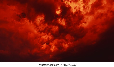 Nature background. Dramatic clouds on the sky in red colors