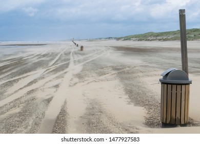 Nature background featuring sand gone with wind in summer windy day on North Sea coast near the Hague in the Netherlands. Abstract sand surface with traces illustrating stormy day and blowing wind.