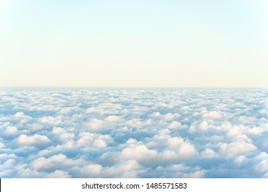Nature background of morning sunrise blue sky with carpet of white fluffy clouds. Clean environment background