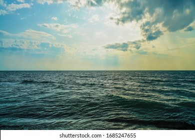 nature background. sea and blue dramatic sky. tide at sea during blue twilight in cloudy weather on short exposure