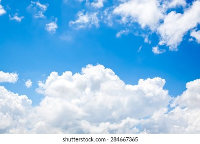 nature background. white clouds over blue sky soft focus.