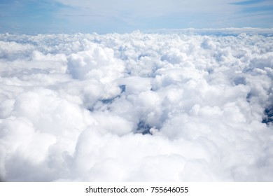 Nature background white clound and blue sky view from airplane windows