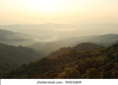 Nature  backgrounds /Dramatic clouds with mountain and tree: Mountain forests in Myanmar.