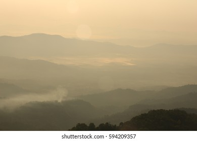Nature  backgrounds/Dramatic clouds with mountain and tree: Mountain forests in Myanmar