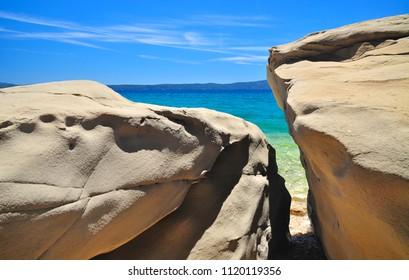 Nature beach scene with stones and sea