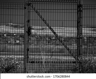 nature and the building behind the cage fence black and white photo the meaning of life