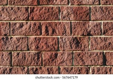 Nature color rough hewn brick wall textured background template