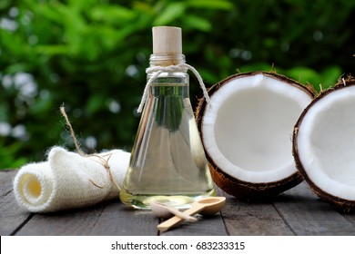 Nature cosmetic products, coconut oil from copra in glass jar on green background, essential oil for skin care, rich vitamin, organic cosmetic also massage oil at spa