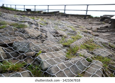 nature ground, stone protection by metal net in mountain area