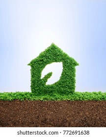 Nature is home concept. Grass growing in the shape of a house with a cut out leaf, symbolizing the need to build sustainable homes, protect the environment and reconnect with nature.